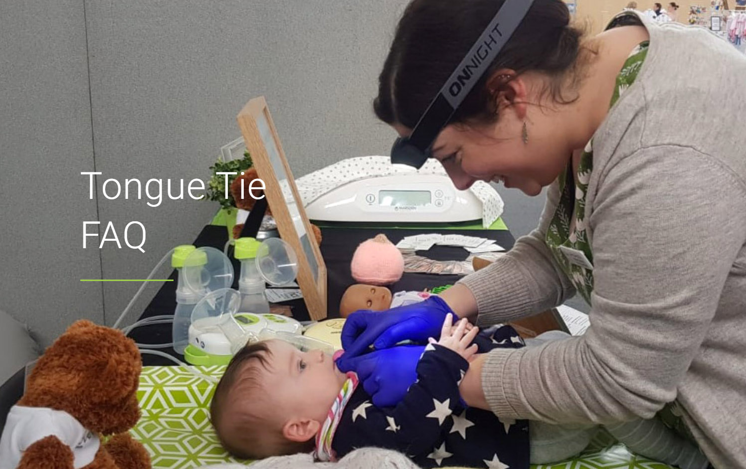 Baby being examined for tongue tie